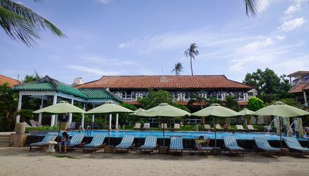 inground: Phan Thiet, Vietnam - Jun 3, 2017. Swimming pool of luxury resort at summer in Phan Thiet, Vietnam. Phan Thiet belongs to Binh Thuan province and located 200km South of Cam Ranh Bay.