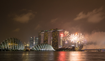 lake district: Singapore - Jul 4, 2015. Fireworks at Marina Bay in Singapore. Singapore has a highly developed market economy, based historically on extended entrepot trade. Editorial