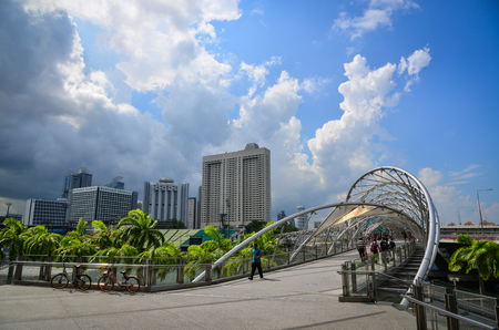 Singapore - Jun 13, 2017. People walking on Helix Bridge at Marina Bay in Singapore. Marina Bay represents all things modern and super-stylish in Singapore.