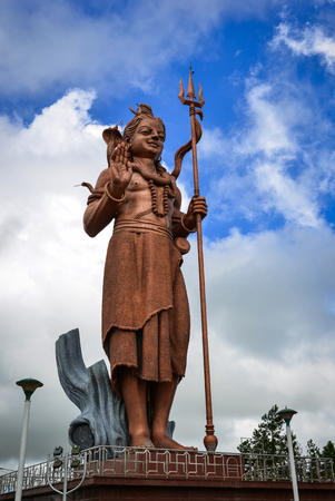 Huge statue of Lord Shiva at Grand Bassin in Mauritius. The 108 ft statue of Shiva in Grand Bassin in the central plateau of Mauritius is really quite impressive.