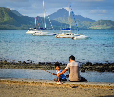 Le Morne, Mauritius - Jan 8, 2017. People relaxing on the bank in Le Morne, Mauritius. Mauritius is a major tourist destination, ranking 3rd in the region and 56th globally. Editorial