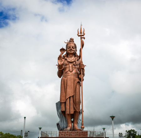 Huge statue of Lord Shiva (Mangal Mahadev) at Grand Bassin in Mauritius. Mangal Mahadev statue is situated in the district of Savanne, in Mauritius. Stock Photo