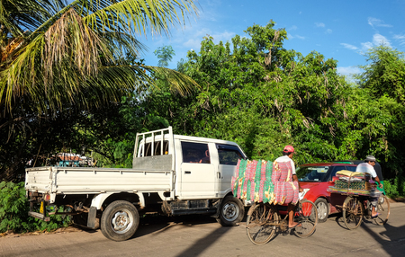 Colombo, Sri Lanka - Sep 5, 2015. Vehicles on street at sunny day in Colombo, Sri Lanka. Colombo is the commercial capital and largest city of Sri Lanka, with a population of 5.6 million.