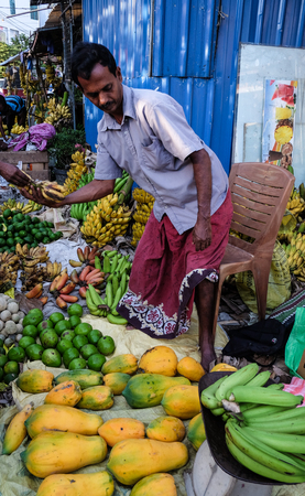 Colombo, Sri Lanka - Sep 5, 2015. A vendor at local market in Colombo, Sri Lanka. Colombo is the commercial capital and largest city of Sri Lanka, with a population of 5.6 million.
