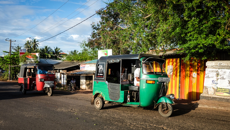 Colombo, Sri Lanka - Sep 5, 2015. Tuk-tuk taxis running on street in Colombo, Sri Lanka. Colombo is the commercial capital and largest city of Sri Lanka, with a population of 5.6 million. Editorial