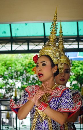Bangkok, Thailand - Jun 20, 2017. Traditional dancers at the Erawan Temple in Bangkok, Thailand. Bangkok is a large city known for ornate shrines and vibrant street life.