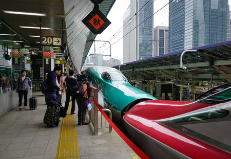 Tokyo, Japan - May 15, 2017. Shinkansen train stopping at railway station in Tokyo, Japan. The Shinkansen is a network of high-speed railway lines in Japan operated by five Japan Railways Group.