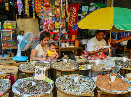 Manila, Philippines - Apr 12, 2017. People sell dried fish at street market in Manila, Philippines. Manila is the capital of Philippines and the most densely populated city proper in the world. Редакционное