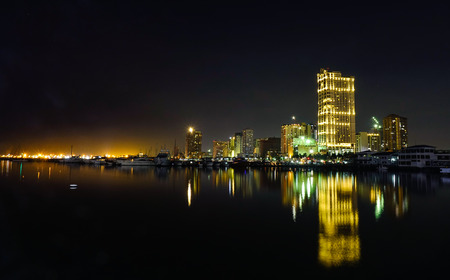 Manila, Philippines - Apr 12, 2017. View of Manila Bay from Harbour Square at night in Manila, Philippines. Manila Bay is a natural harbour which serves the Port of Manila.