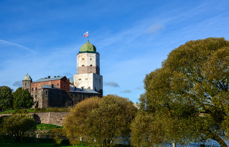 saint: Tower of St. Olav at sunny day in Vyborg, Russia. It is a symbol and an architectural landmark of the city of Vyborg.
