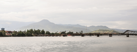 Steel bridge on river in Kampot, Cambodia. Kampot is a small town in south-east Cambodia, and is a gateway to Bokor National Park.