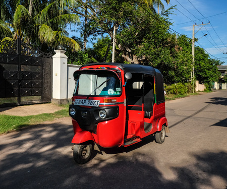 Colombo, Sri Lanka - Sep 5, 2015. A tuk tuk taxi on countryside road in Colombo, Sri Lanka. Colombo is the commercial capital and largest city of Sri Lanka, with a population of 5.6 million. Editorial