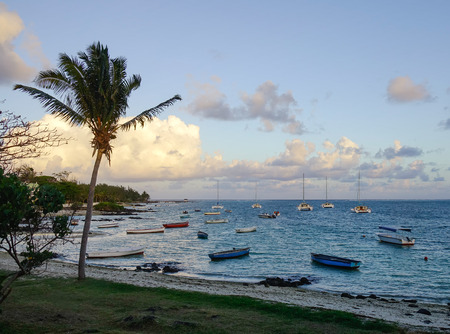 Grand Baie, Mauritius - Jan 11, 2017. Tourist boats docking at Grand Baie in Mauritius. Mauritius, an Indian Ocean island nation, is known for its beaches lagoons and reefs. Editorial