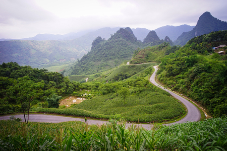 frequented: Mountain road at summer day in Ha Giang, Northern Vietnam. Ha Giang province in northern Vietnam is less frequented by tourists.