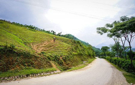 frequented: Mountain road in Ha Giang, Northern Vietnam. Ha Giang province in northern Vietnam is less frequented by tourists.