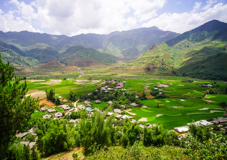Small town at valley in Ha Giang, Vietnam. Ha Giang is the final frontier in northern Vietnam, an amazing landscape of limestone pinnacles and granite outcrops.