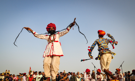 flocking: Pushkar, India - Mar 3, 2012. Folk dance during a festival in Pushkar, India. Pushkar is a much sought-after destination for tourists and devotees flocking to Rajasthan. Editorial