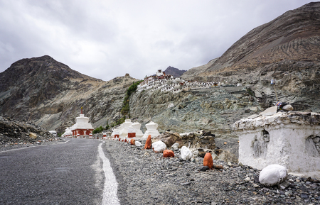Mountain road to a Buddhist temple in Ladakh, India. Ladakh is the highest plateau in the state of Jammu & Kashmir with much of it being over 3000m.