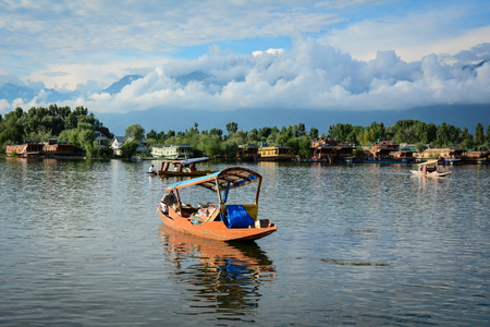 Srinagar, India - Jul 23, 2015. Wooden boats on Dal Lake in Srinagar, India. Srinagar is the summer capital of the Indian state of Jammu and Kashmir.