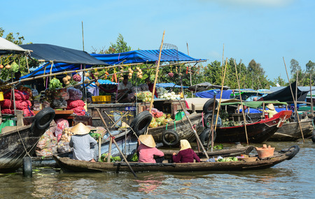 Can Tho, Vietnam - Feb 2, 2016. People at Cai Rang floating market on river in Can Tho, Vietnam. Can Tho is noted for its floating market, and picturesque rural canals.