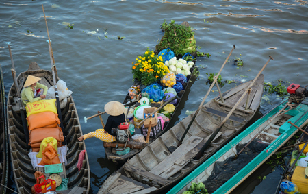Cai Rang, Vietnam - Feb 2, 2016. Wooden boats docking on river in Cai Rang, Vietnam. Floating market at Cai Rang is the old traditional market of South of Vietnam.