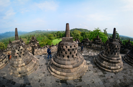 Java, Indonesia - Apr 15, 2016. People visit Borobudur Temple on Java, Indonesia. Built in the 9th century, the temple was designed in Javanese Buddhist architecture.