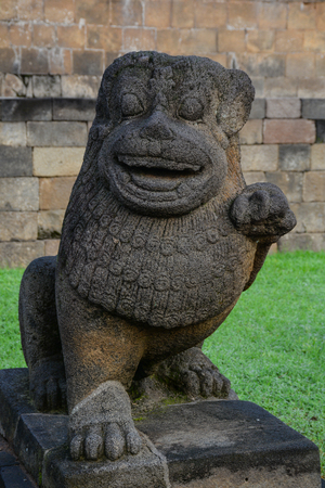 ubud: Lion guard statue at an ancient temple in Bali Island, Indonesia.