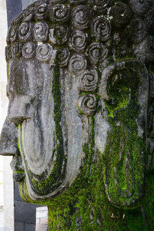 Head of Buddha statue at Borobudur on Java, Indonesia. Built in the 9th century, the temple was designed in Javanese Buddhist architecture.
