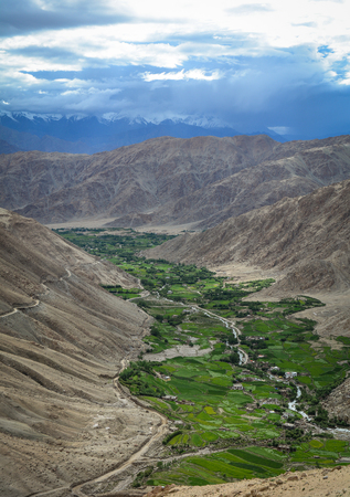 Green valley at sunny day in Ladakh, India. Ladakh is a mountainous region in northwest India and in the area known as the Trans-Himalaya.