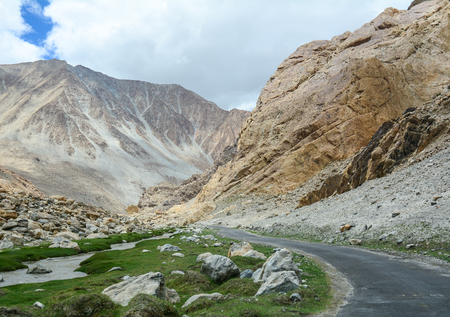 Mountain road at sunny day in Ladakh, India. There are about 1,800 km of roads in Ladakh of which 800 km are surfaced.