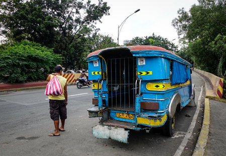 Manila, Philippines - Dec 21, 2015. A jeepney stopping on street at downtown in Manila, Philippines. Manila is the center of culture economy education and government of the Philippines.
