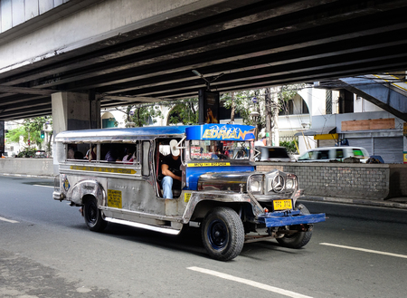 Manila, Philippines - Dec 20, 2015. A jeepney running on street in Manila, Philippines. Manila is the center of culture economy education and government of the Philippines.