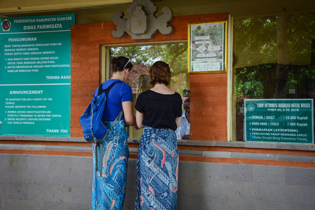 Bali, Indonesia - Apr 21, 2016. People waiting at ticket booth of Uluwatu temple in Bali, Indonesia. Bali is a popular tourist destination which has seen a significant rise in tourists since 1980s.