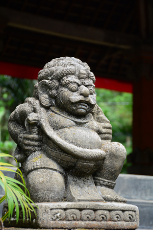 ubud: A God statue at the ancient temple in Bali, Indonesia. Bali is the most popular island holiday destination in the Indonesian archipelago.