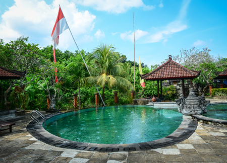 inground: Bali, Indonesia - Apr 22, 2016. Swimming pool at luxury resort in Bali, Indonesia. Bali received the Best Island award from Travel and Leisure in 2010. Stock Photo