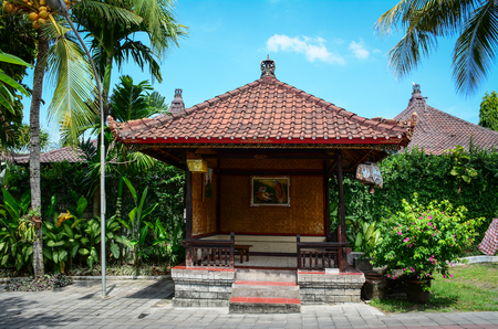 Bali, Indonesia - Apr 22, 2016. A wooden house at luxury resort in Bali, Indonesia. Bali received the Best Island award from Travel and Leisure in 2010.