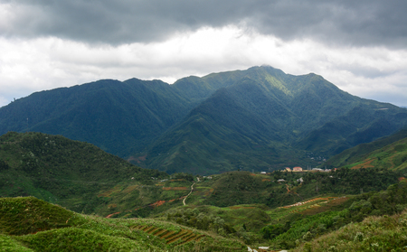 Mountain scenery at summer day in Sapa Township, Northern Vietnam. Sa Pa is a quiet mountain town and home to a great diversity of ethnic minority peoples.