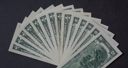 Close-up of US Dollars (USD banknotes) with black background Stock Photo