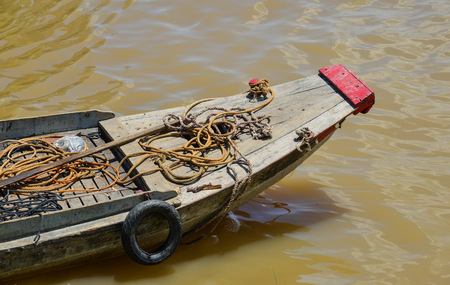 A wooden boat on Mekong River in flooding season in Southern Vietnam. Stock Photo