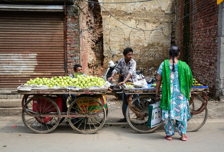 Amritsar, India - Jul 25, 2015. People selling fresh fruits on street in Amritsar, India. Amritsar is home to the Harmandir Sahib, the spiritual and cultural centre for the Sikh religion. Editorial
