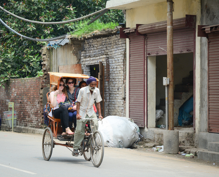 Amritsar, India - Jul 25, 2015. A man riding rickshaw in Amritsar, India. Amritsar is a holy city in the state of Punjab in India. It lies about 25 km east of the border with Pakistan.