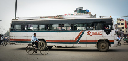 Amritsar, India - Jul 25, 2015. Local bus running on street in Amritsar, India. Amritsar is home to the Harmandir Sahib, the spiritual and cultural centre for the Sikh religion. Editorial