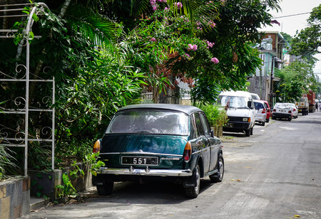 Mahebourg, Mauritius - Jan 15, 2017. Cars parking on street in Mahebourg Mauritius. Mauritius an Indian Ocean island nation is known for its beaches lagoons and reefs. Editorial