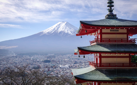 View of Mount Fuji from Chureito Pagoda at sunny day. The symbol of Japanese culture, Mt. Fuji, an active volcano is the highest mountain in the country.