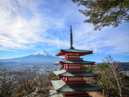 Chureito Pagoda with Mount Fuji in Yamanashi, Japan. The pagoda is a five storied pagoda resting on the side of a nearby mountain facing Fuji. Editorial