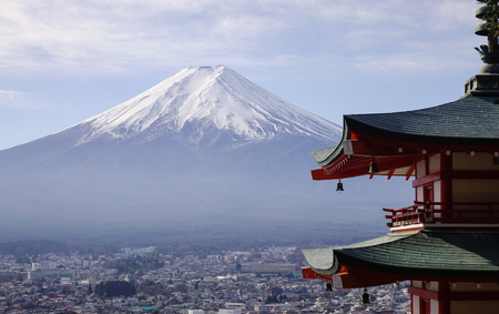 View of Mount Fuji from Chureito Pagoda at winter. The symbol of Japanese culture, Mt. Fuji, an active volcano is the highest mountain in the country.