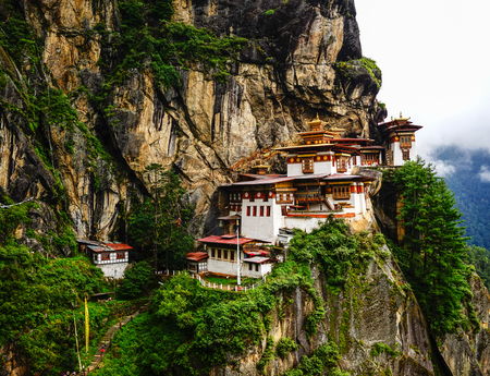 Paro Taktsang (Tiger Nest) at summer day in Upper Paro Valley, Bhutan. Taktsang Lhakhang is Bhutan most iconic landmark and religious site. Stock Photo