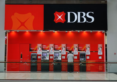 Singapore - Jun 13, 2017. DBS ATM Booth at shopping mall in Singapore. Singapore economy has been ranked as the most open in the world, most pro-business, with low tax rates. Редакционное