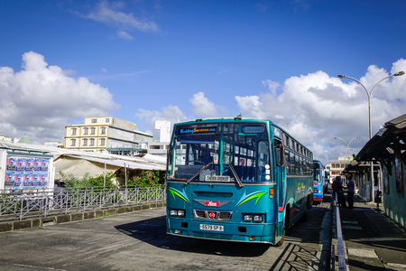 Port Louis, Mauritius - Jan 6, 2017. A bus stopping at station in Port Louis, capital of Mauritius. Port Louis is the business and administrative capital of the island.
