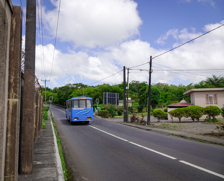 Port Louis, Mauritius - Jan 6, 2017. A bus running on rural road in Port Louis, capital of Mauritius. Port Louis is the business and administrative capital of the island.